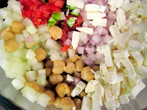 Mixing of boiled chickpeas and other veggies